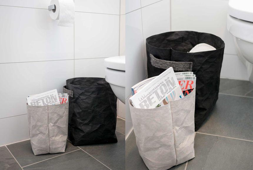 Dekoration_im_WC_Toilette_Zeitungen_Papier